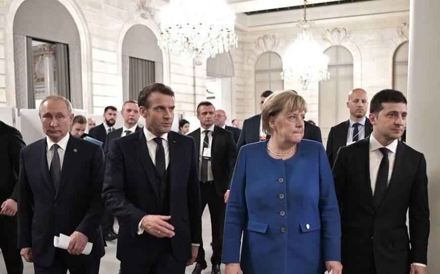 Pour Merkel, Poutine est le «vainqueur» du sommet Normandie à Paris